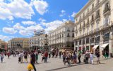 Madrid, Spain - May 31, 2015: Pedestrians walking through Puerta del Sol in Madrid, Spain. This is the very centre of Madrid and is a busy area for shopping.